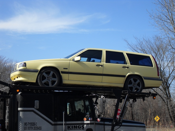 Volvo 850 T5R yellow wagon. Shipped from Kansas to New York, and followed by a string of ...