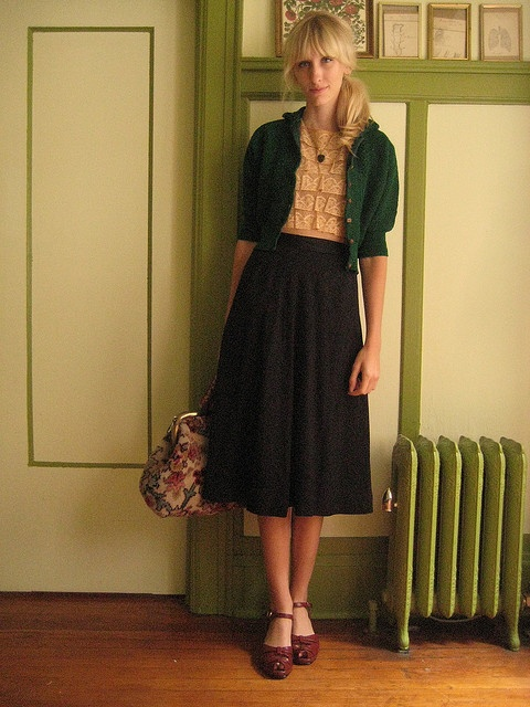 Cropped cardigan, blouse, skirt, shoes.