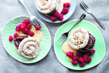 Cinnamon and chocolate ganache meringues with vanilla sauce - looks the only non-std pantry ingredient is hazelnuts. Yum.