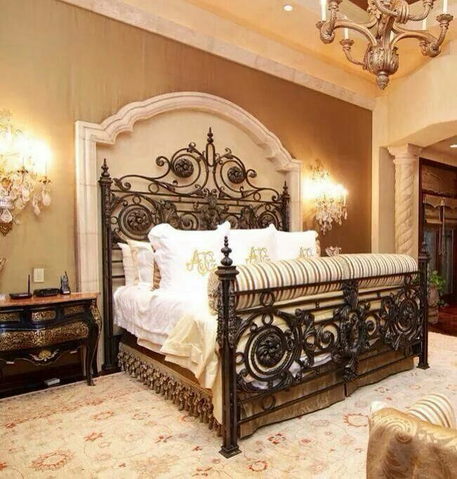 iron bed. Mediterranean master bedroom, custom bedding DesignNashville.com