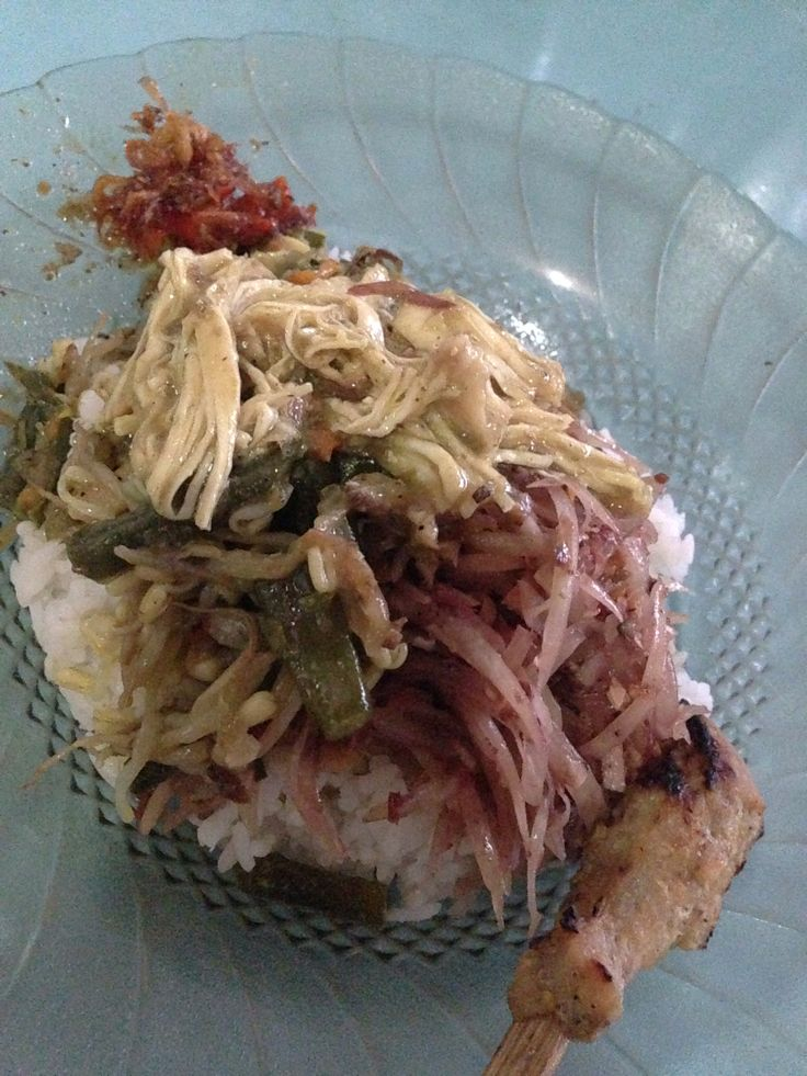 Nasi Lawar - traditional Balinese rice mix; rice with chicken betutu, skrew chicken sate lilit, lawar