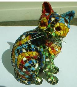 cover an old thrift store statuette with mosaic tiles....love thrift stores.,I will be on the lookout for the perfect garden statue to mosaic