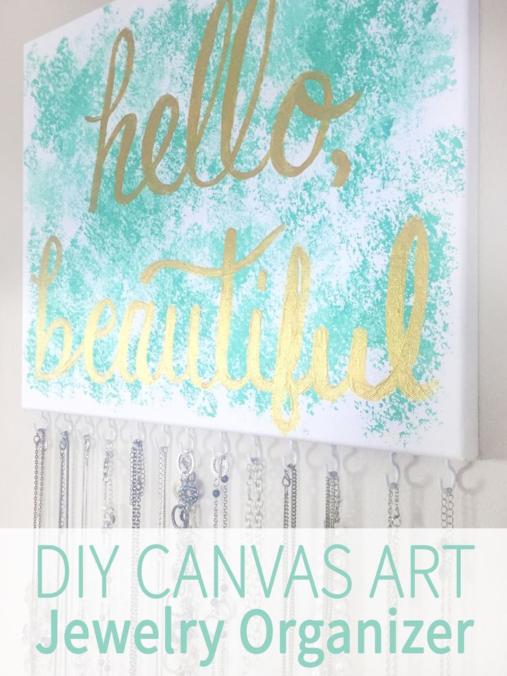 DIY canvas art jewelry organizer. It's art and a necklace holder!