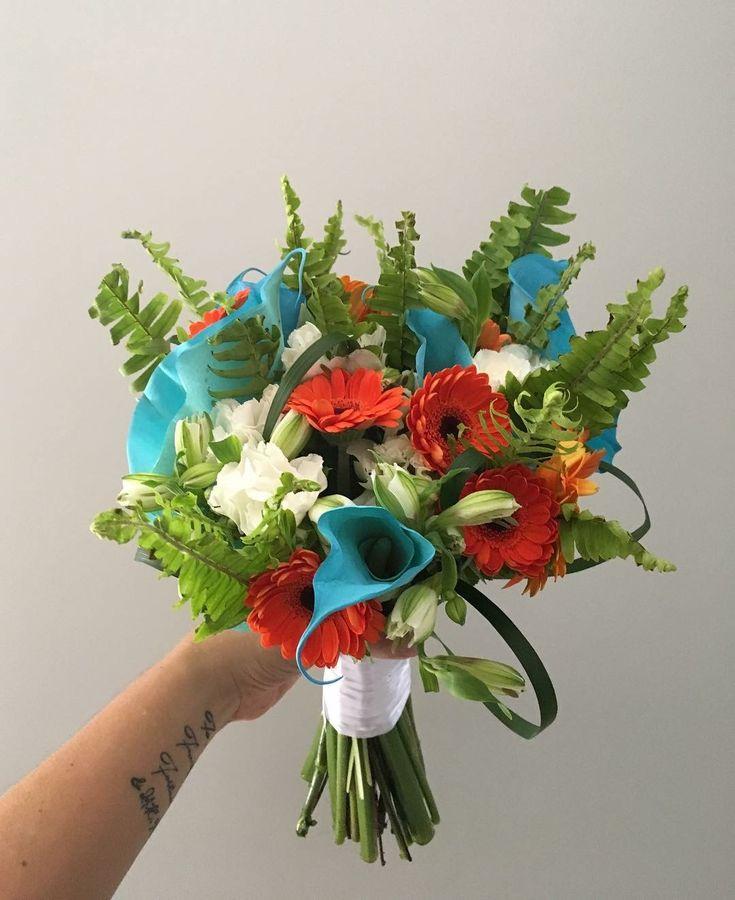 CBR472 wedding Riviera Maya turquoise and orange flowers bride bouquet