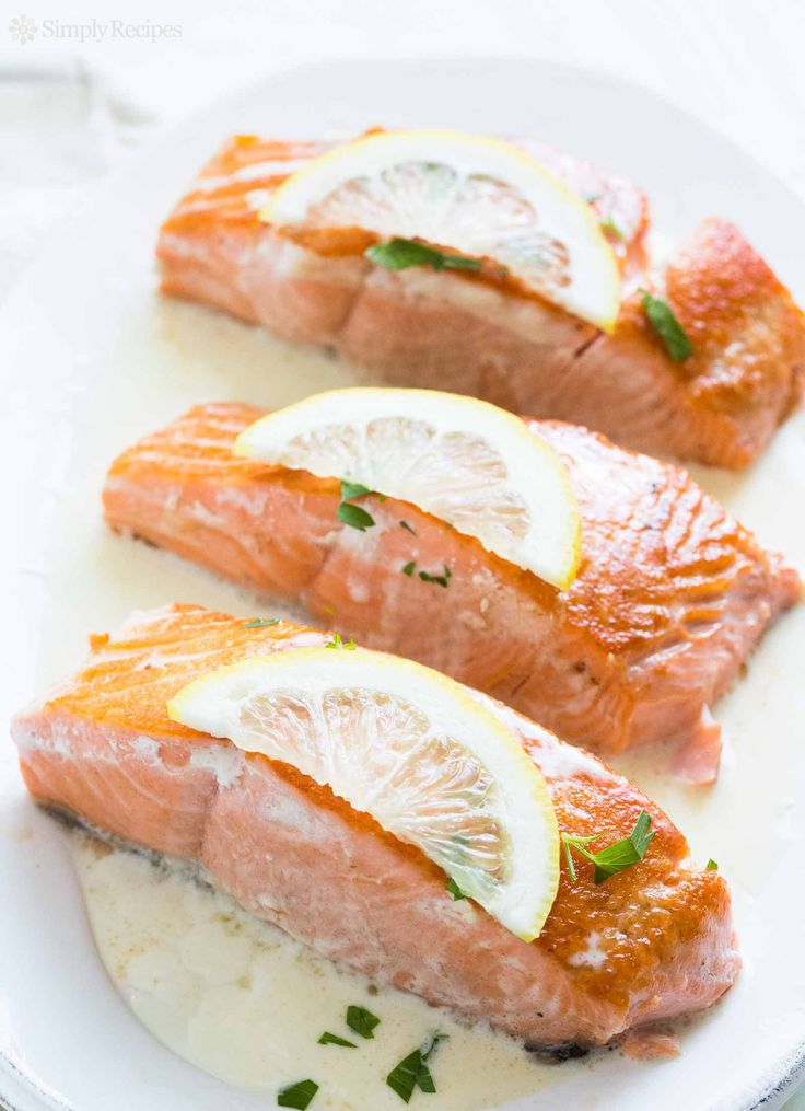 Sautéed salmon fillets served with a simple lemony cream sauce. So easy! Takes only 20 minutes to make! Low carb and gluten-free. On SimplyRecipes.com