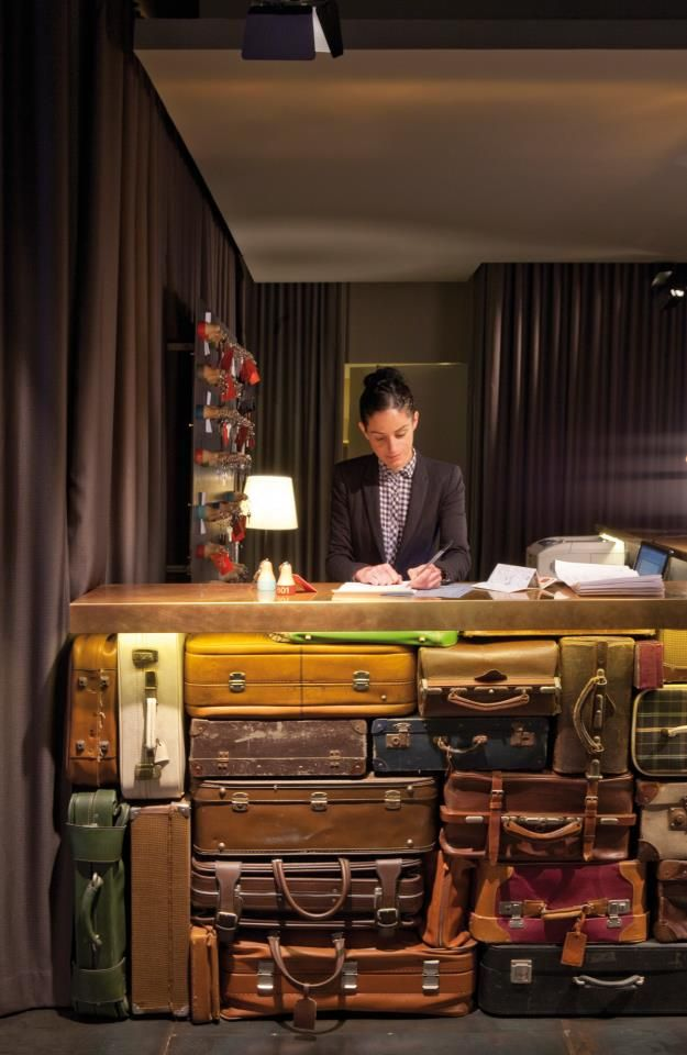 A desk made out of leather bags at The Chic & Basic Ramblas Hotel By Lagranja Design In Barcelona