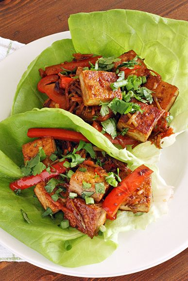 Spicy Tofu Lettuce Wrap by taste-for-adventure: Low carb, this is tossed with soy sauce and plum sauce and sriracha and garlic and all sorts of other good stuff and  tucked inside a wrap of buttery-soft lettuce!  #Lettuce_Wrap #Tofu #Healthy