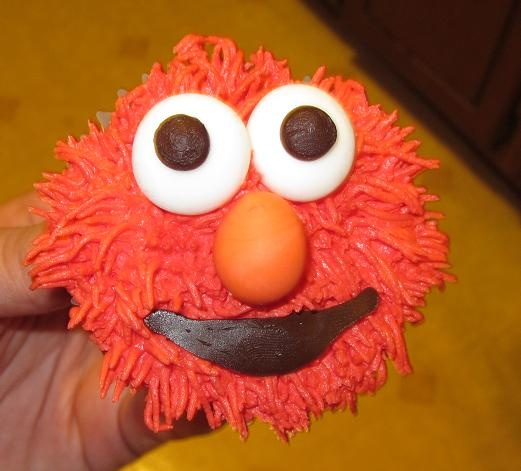 Elmo cupcakes! The key to making these look right was adding some cheeks on the side. Elmo's head is not a circle!