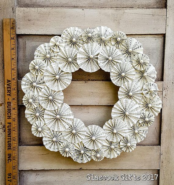 Beautiful handmade wreath crafted from reprinted vintage Christmas sheet music on Ivory parchment paper. 14 diameter, it is simply stunning elegance on any wall! With its sturdy wire hanger, it is ready to display! We have a wide variety of colors, sizes, and styles of holiday and home decor items in our store - Check them out.