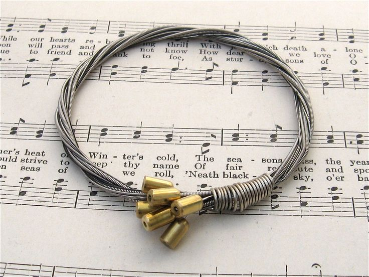 This is a bracelet that I made out of recycled electric guitar strings. This is an excellent gift idea for the male or female music lover on your shopping list. In this bracelet, I used a full set of six strings from an electric guitar with Fender Bullet ends attached. The strings used in this bracelet are silver colored, probably a nickel alloy. A word on sizing: After making dozens of bracelets for friends and family; I was custom fitting each one for comfort, I started measuring them…