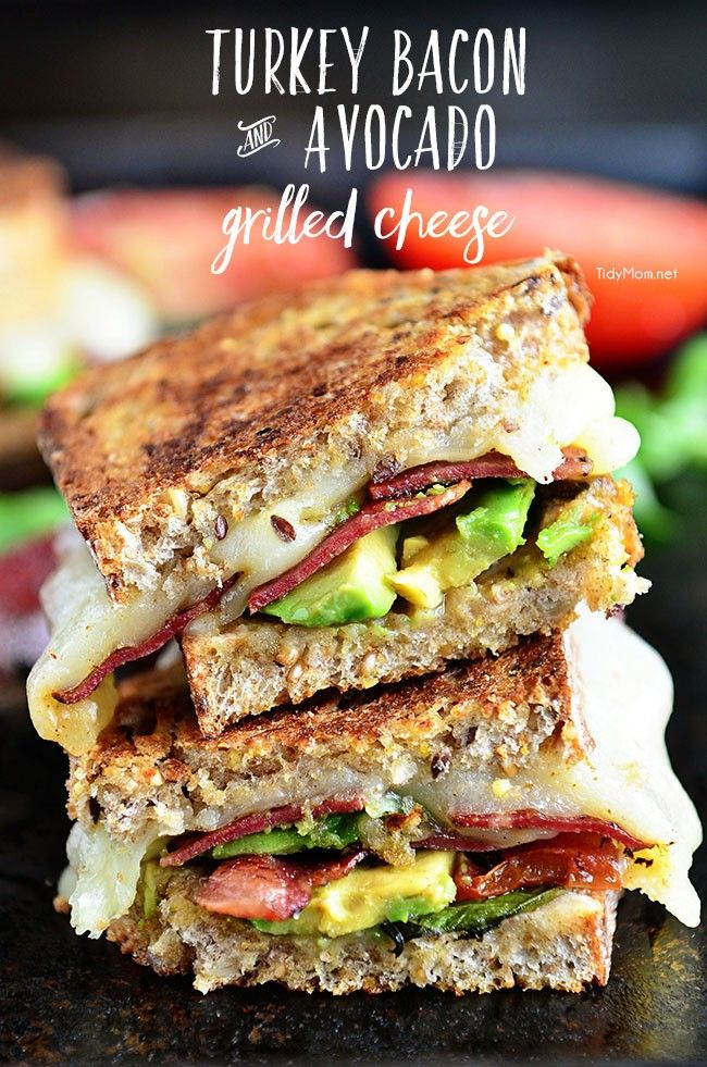 Turkey Bacon and Avocado Grilled Cheese sandwich with basil, tomatoes and mozzarella