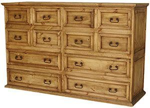 This extra-large rustic dresser has enormous storage space in twelve drawers to keep even the largest clothing collections organized and easily accessible. The fronts of the drawers feature stylish iron handles and the solid pine has a beautiful distressed finish. This southwestern style goes well with most casual decor.