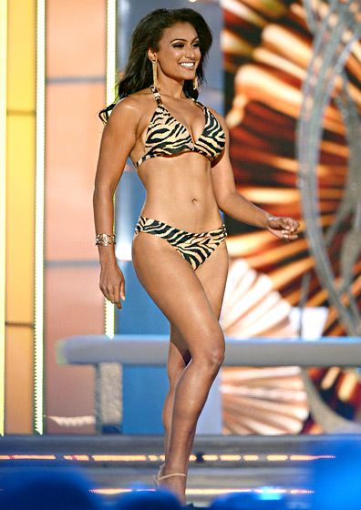 "Miss America 2014 winner, Miss New York Nina Davuluri, strutted her stuff onstage in a leopard-print bikini, later boldly brushing off racist reactions following her win. ""I have to rise above that. I always viewed myself as first and foremost American,"" she told The Associated Press."
