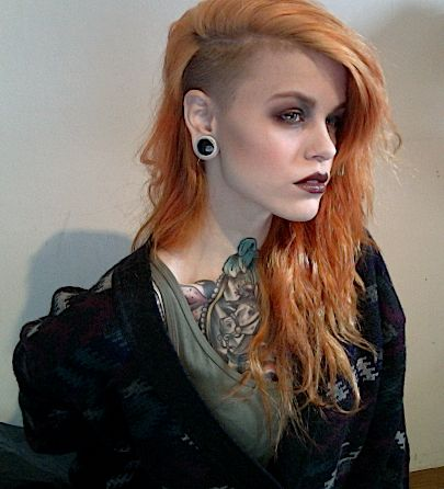 Shaved side. Undercut. Orange ginger hair. Long ann wavy.