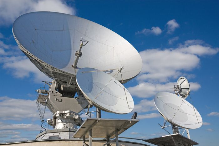Satellite television is television programming delivered by the means of communications satellite and received by an outdoor antenna.