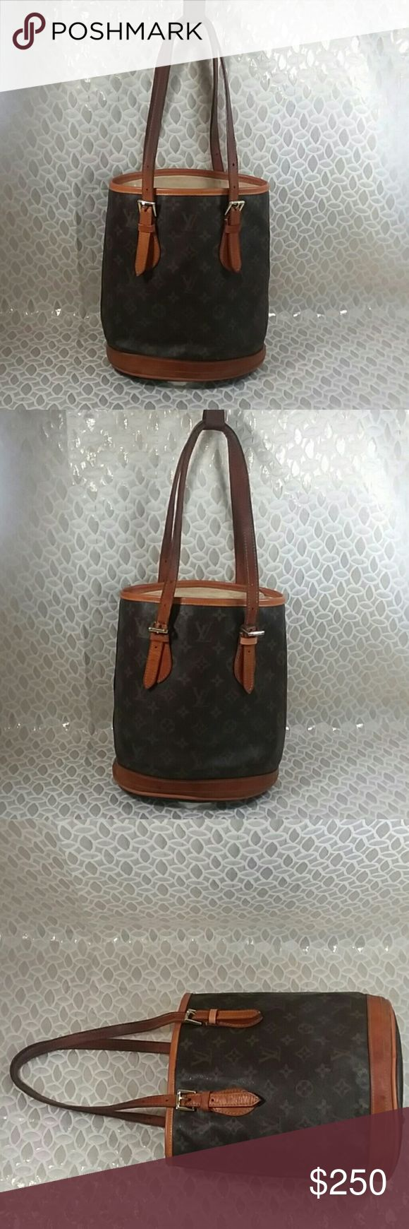 Authentic Louis Vuitton Monogram Bucket Brown Bag. The inside linen was restitched. The bag was made in France with a date code SD 0090. Straps and leather showed signs of used as the bag was preowned. Canvas is good. The dimension is 10, 6 and 8. Louis Vuitton Bags Shoulder Bags