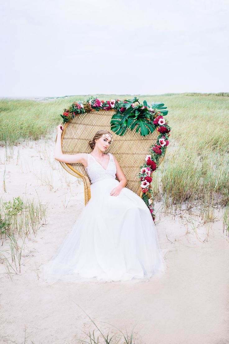 In every woman there is a queen! A peacock chair that is beautifully decorated with flowers adds a lot of bohemian vibes to a wedding