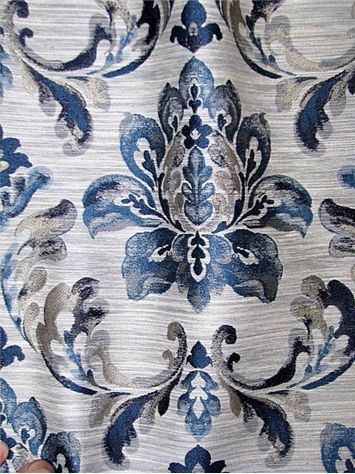 "Beka Indigo - Floral medallion jacquard tapestry fabric. Perfect for upholstery fabric, drapery fabric, top of the bed fabric or slipcover fabric. Durable 51,000 double rubs. Content; 87% poly / 13% linen. Repeat; V 20"" x H 13.7"". 54"" wide."