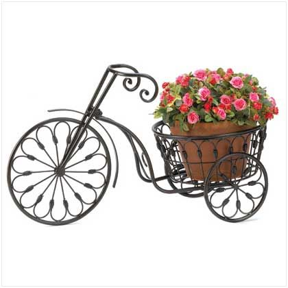 Oh, my goodness this bicycle plant stand is adorable. I love the detailed metal work and how fun and whimsical it is. It is also great that a larger pot could fit in that seating area. That way you could put big plants in this as well.  This would seem like it would make a yard fun and unique in a flash.
