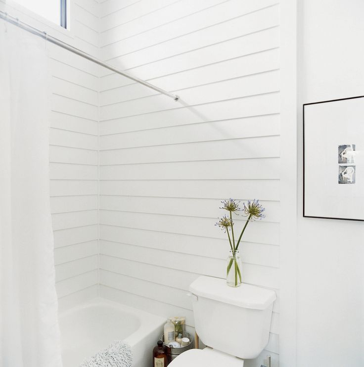 In the bathroom, unexpected materials, such as a cement board shower surround, were often cheaper and easier to install than more traditional ones.
