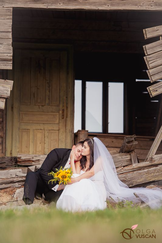 bride and groom next to a wrecked cottage_images by Olga Vuscan