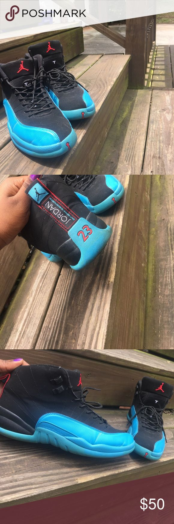 Air Jordan 12 Black and Blue. Size 10 in Men Worn twice with non noticeable brown marks that can easily be washed. Teal/ blue color. Size 10 in men. No trade Air Jordan Shoes Sneakers
