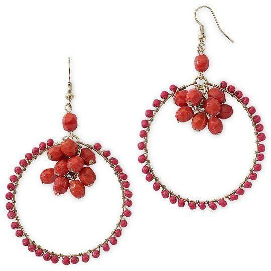 Why choose between hoop and cluster earrings when you can have both? Red beads add a pop of passion to these whimsical drop earrings. Metal: Gold-tone metal Stones: Red beads Back: Wire... More Details