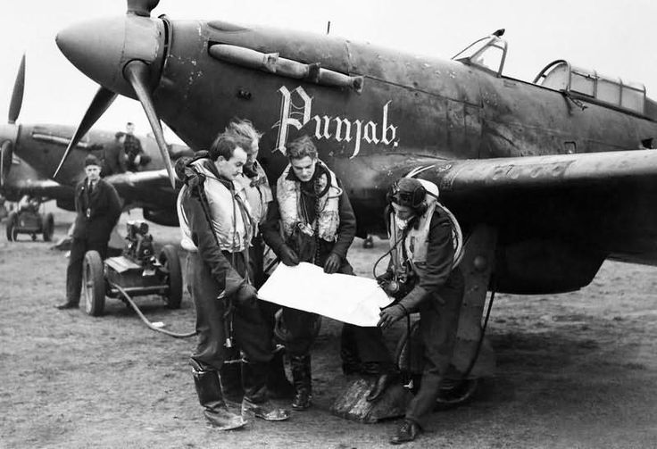 Pilots and Hurricanes of No 56 Punjab Squadron at Duxford 2 January 1942