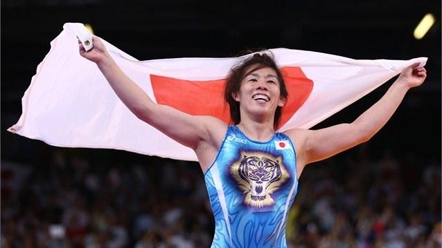 Saori Yoshida of Japan celebrates winning the gold medal over Tonya Lynn Verbeek of Canada in the Women's Freestyle 55 kg Wrestling on Day 13.