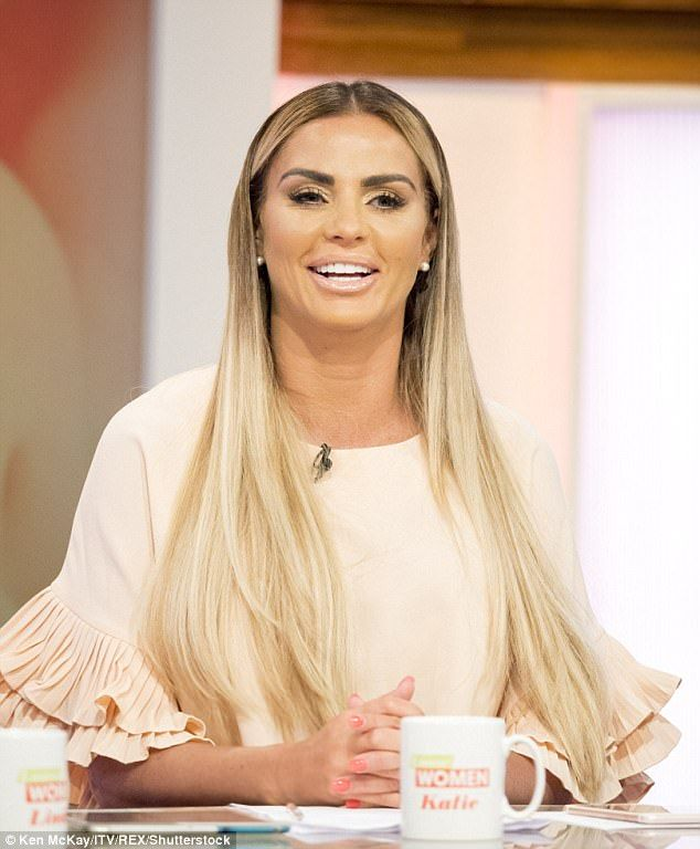 Roaming free: Katie Price has revealed that she lets her two youngest children 'pee and poo' in her back garden