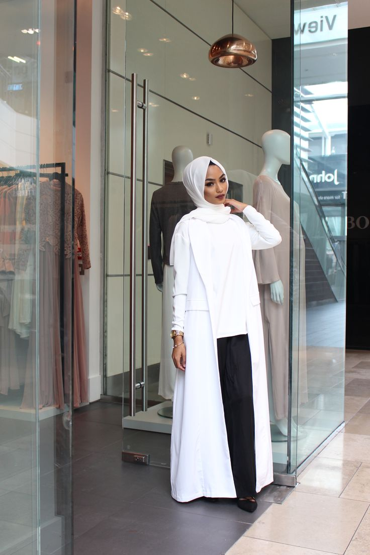 INAYAH | The lovely Sabina Hannan wearing: Off-White Belted #Coat + White Crepe Top + Black Straight Leg #Trousers + White Georgette #Hijab - shop the collection at www.inayah.co