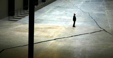 Mind the crack ... a visitor looks at Doris Salcedo's Turbine Hall installation. Photograph: Anton Hammerl/PA. Shibboleth. Doris Salcedo. 2007–2008 C.E. Installation.