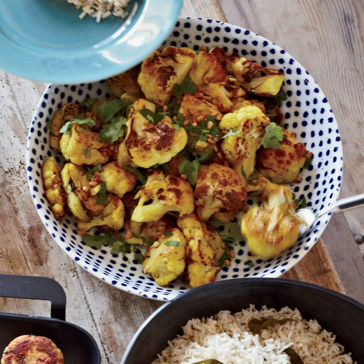 Fragrant cumin, turmeric, cilantro and mint turn simple roasted cauliflower into a vibrant and delicious dish.