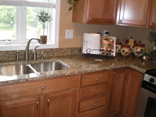This is very close to the granite we had installed in our kitchen. We went with Brazil gold. Love it!