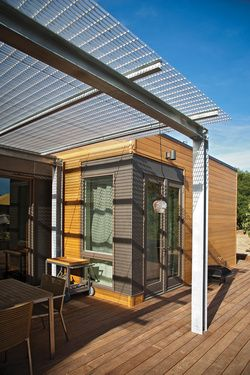 The deck is shaded by an awning made of reclaimed factory catwalk.