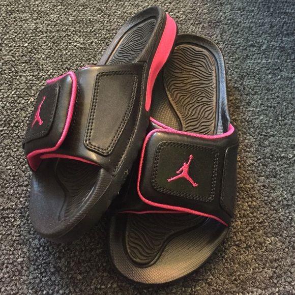 Black and pink Jordan slip on sandals Brand new, hasn't been worn Jordan Shoes Sandals