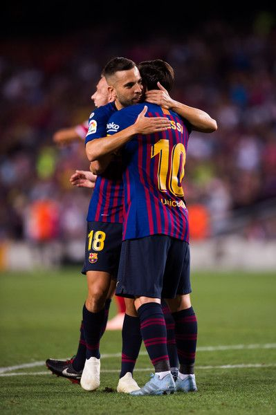 a90e5af60 Lionel Messi of FC Barcelona celebrates with his teammate Jordi Alba after  scoring the opening goal during the La Liga match between FC Barcelona and  Girona ...
