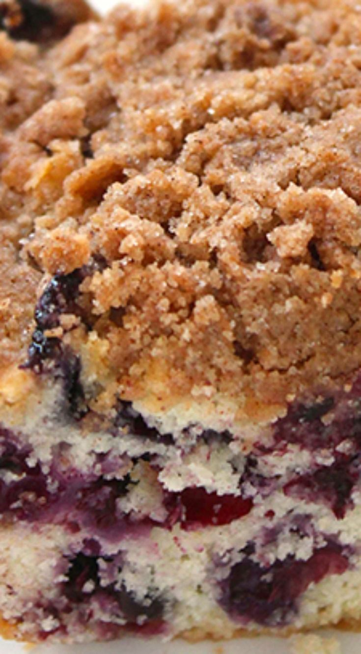 Blueberry Buckle Recipe ~ Perfect for breakfast, snack, or dessert.... Plump blueberries meet up with a coffee muffin type cake then topped with a cinnamon and butter streusel.
