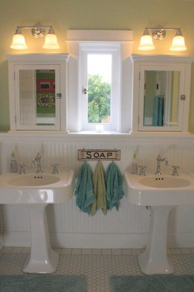 love the sinks and medicine cabinets w/ window in the middle - wonderful colors and low hooks for self service kiddo towel hanging