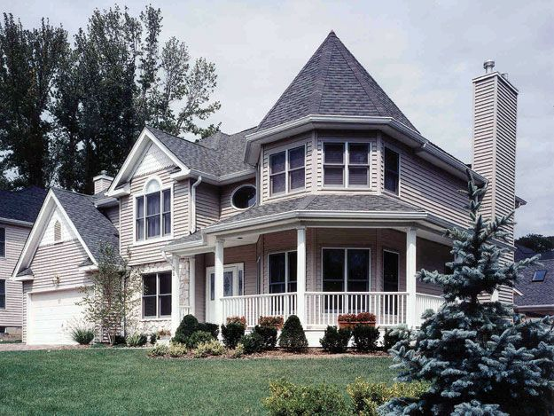 The covered porch two story foyer and attractive accents for Double storey victorian homes