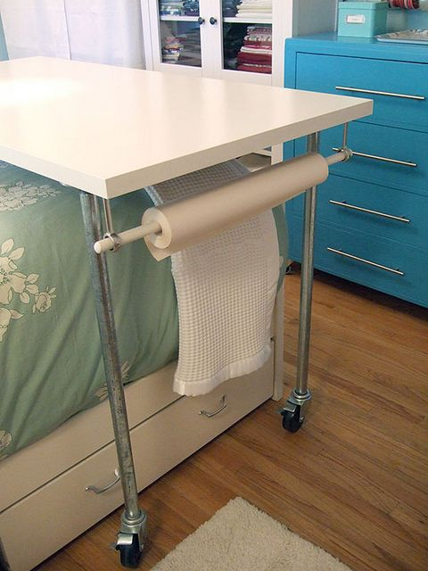 rolling over-the-bed craft table by craftynest, via Flickr: Paper Holders, Crafts Shit, Crafts Rooms, Crafts Tables, Art Crafts Studios, Paper Rolls Storage, Craft Tables, Guest Rooms, Paper Ideas
