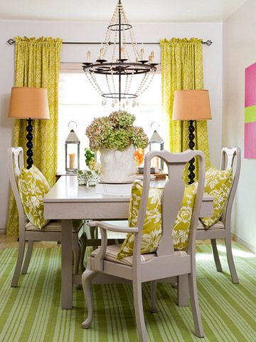The dining room colors with green palette and hints of pink would work great in the eat in kitchen. The green adds freshness like the kitchen produce and a dash a pink its the element of surprise