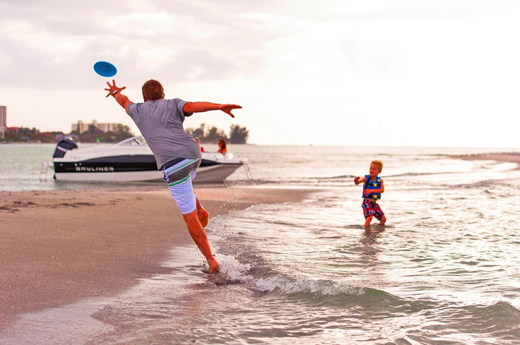 A day on the beach playing frisbee with Dad. What more could a kid want? #family #fun