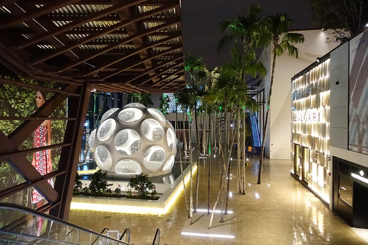 The re-creation of Buckminster Fuller's Fly's Eye Dome floats appears to float on water and light. Palm Court, Miami Design District. Master architect: SB Architects. Photograph by Robin Hill.