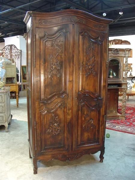 Antique French Armoire in the Transitional Style with Musical Trophy Frontal Panels