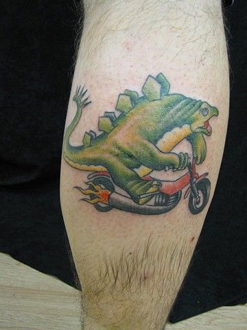 Motorcycle tattoos dinosaur tattoos and tattoo for Traditional motorcycle tattoo