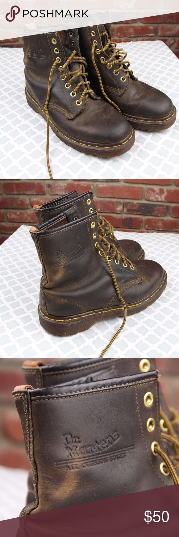Dr. Marten's Air Wair Boots AW004 Made in England Dr. Marten Air Wair 8 eyelet brown leather boots.  UK size 5, good used condition, plenty of life left in them.    UK size 5 corresponds to a US womens size 7, according to Dr. Marten's website.   Made in England. Dr. Martens Shoes Lace Up Boots