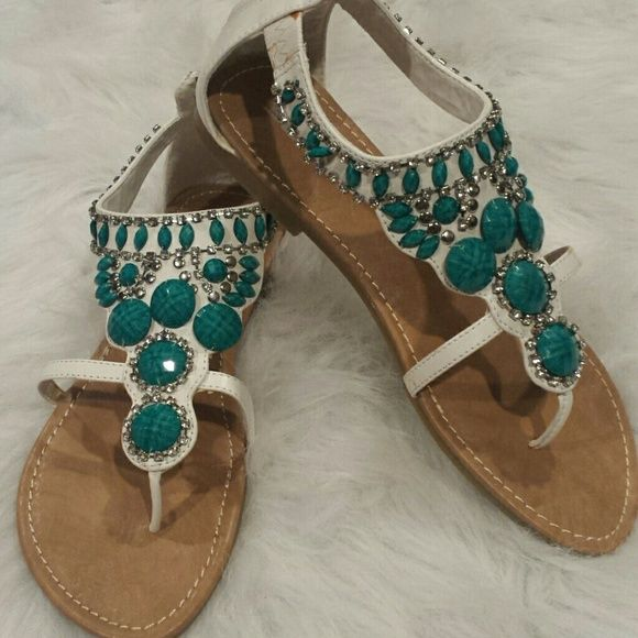 Turquoise/Bling sandal These Turquoise/Bling sandals are very pretty!!! They've never been worn and are in original box. Shoes Sandals