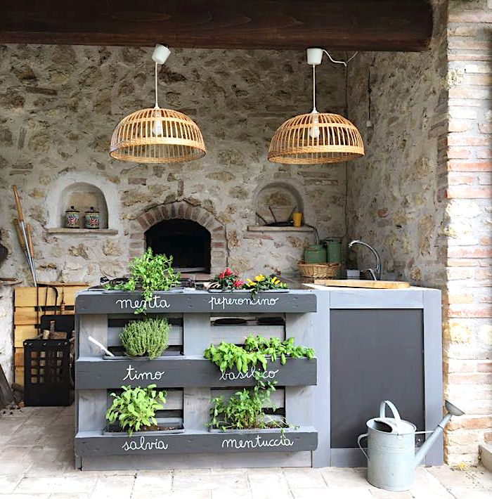 Outdoor kitchen with vertical herb garden from a pallet