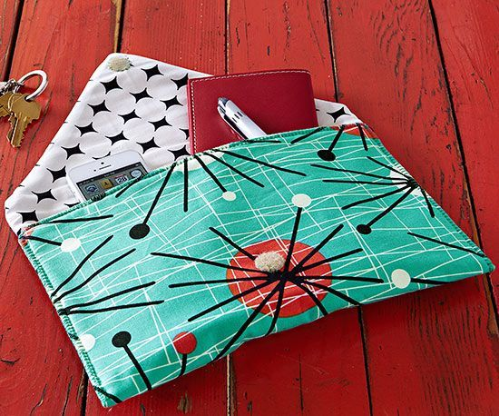 """This clutch is """"sew"""" simple -- it's an open-and-shut case. All you need are three rectangles: one batting, one print for the exterior, and one print for the lining."""